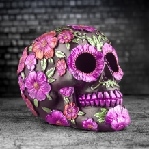 dead skull decoration with pink flowers